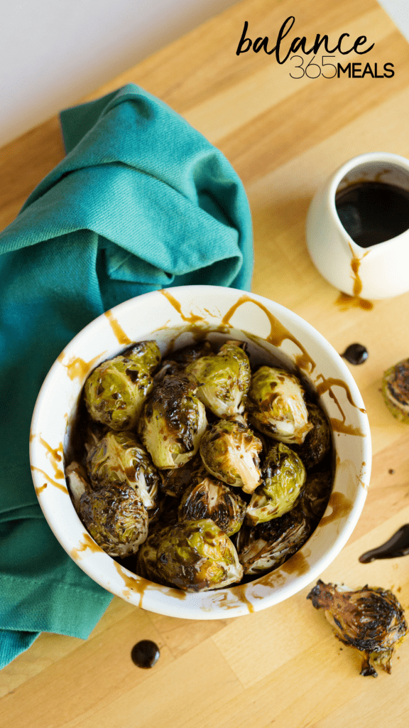 Balsamic Roasted Brussel Sprouts - Change the way your family feels about brussel sprouts by roasting them until caramelized and drizzling them with a sweet honey balsamic glaze. You'll never go back to boiling brussel sprouts again! Easy and simple but makes a fancy side dish. Keep the leftover glaze in your fridge to drizzle over toast, sliced fruit, or any roasted veggie!